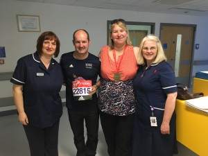 Marathon runner Mike, with Julie King and staff from Ward 33